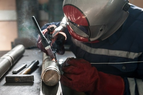 Man Welding In Workshop Photograph Istock 520330786 Maki Shmaki
